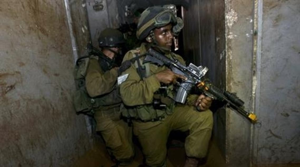 AFP Israeli infantry soldiers from the Kfir Brigade take part in a drill in urban warfare  Read more:
