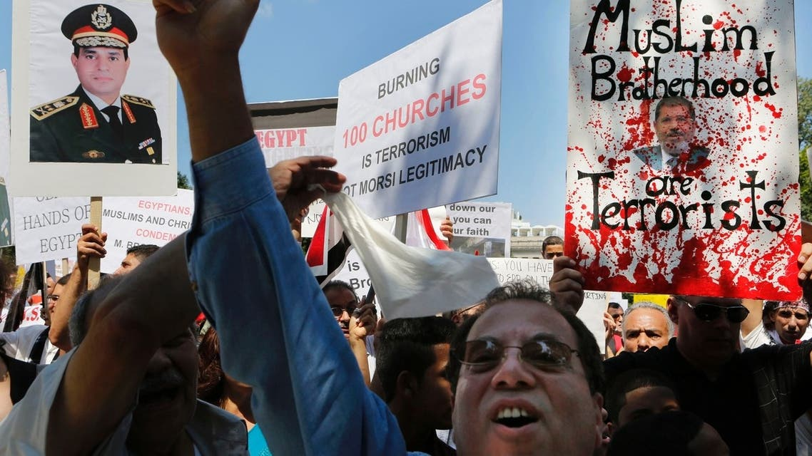 Protesters demonstrate against violence in Egypt in front of the White House while in Washington August 22, 2013. REUTERS