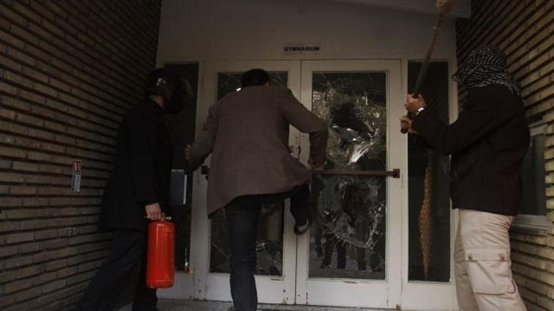 Protesters break through a door in the British embassy compound in Tehran. (File Photo: Reuters)