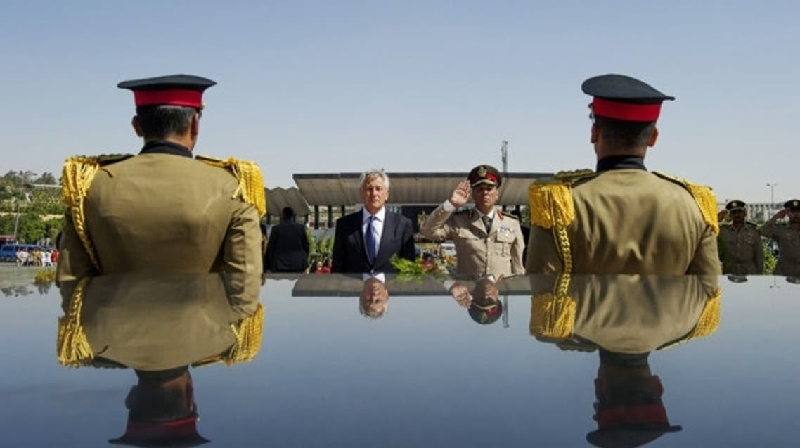 U.S. Secretary of Defense Chuck Hagel stands with an Egyptian army official AFP