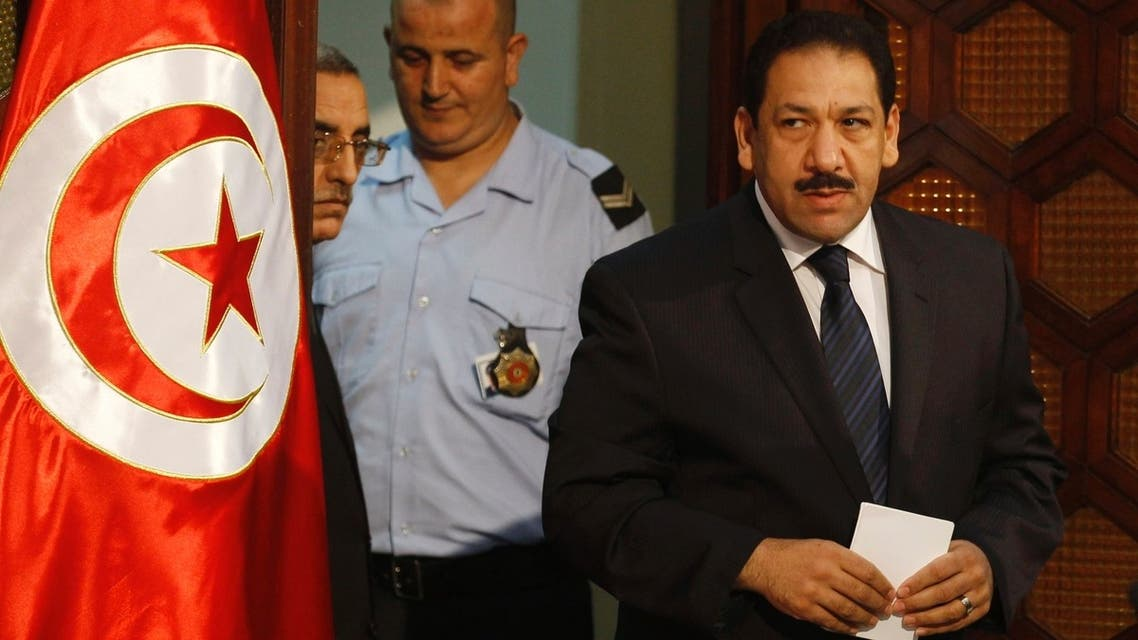 Tunisia's Interior Minister Lotfi Ben Jeddou (R) arrives for a news conference in Tunis Aug. 28, 2013. (AFP)