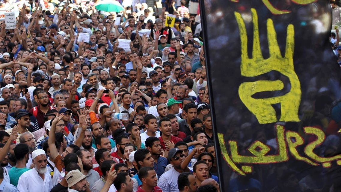 """A flag of the """"Rabaa"""" gesture, in reference to the police clearing of Rabaa Adawiya protest camp on August 14, is pictured during a protest by supporters of Muslim Brotherhood and ousted Egyptian President Mohamed Mursi in Cairo August 23, 2013. Reuters"""