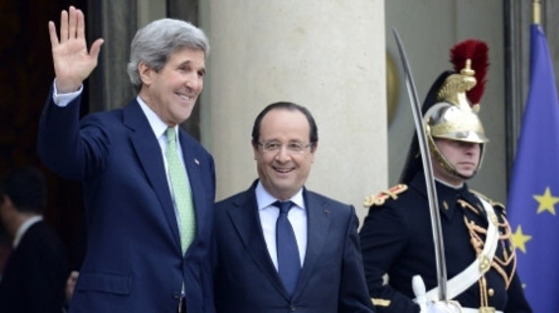 A file photo picture shows U.S. Secretary of State John Kerry outside the ELysée Palace with François Hollande. (AFP)