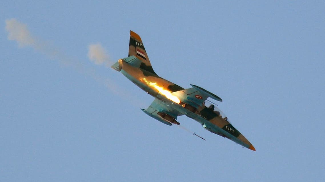 A Syrian Air Force fighter plane fires a rocket during an air strike in the village of Tel Rafat, some 37 km (23 miles) north of Aleppo in this August 9, 2012 file photograph. reuters