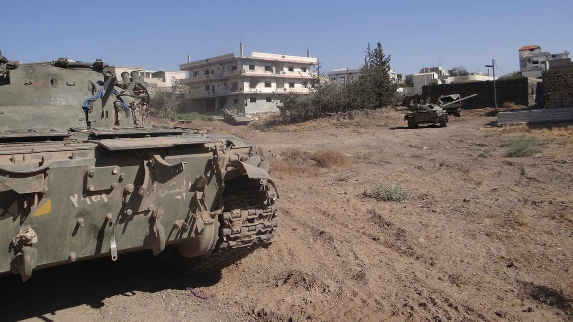 Free Syrian Army (FSA) fighters are seen at a tank that belonged to forces loyal to Syria's President Bashar al-Assad after the FSA said they fought and defeated government troops in the town of Basr al-Harir in the southern province of Deraa in this August 27, 2013 Reuters