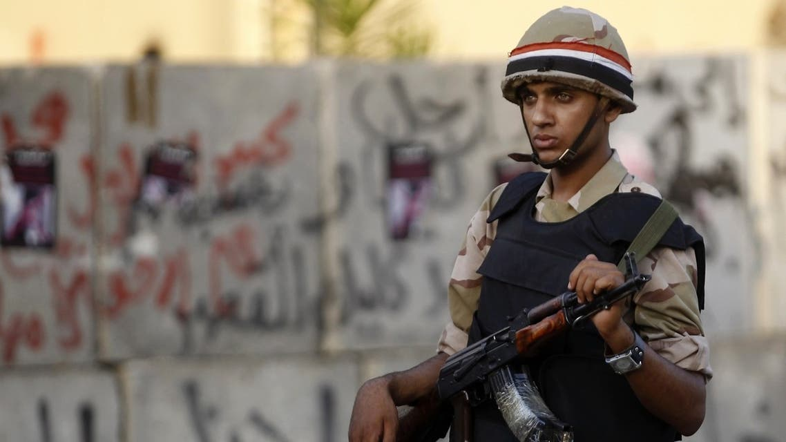 An Egyptian army soldier stands guard in front of the Ittihadiya presidential palace in Cairo. (File photo: Reuters)