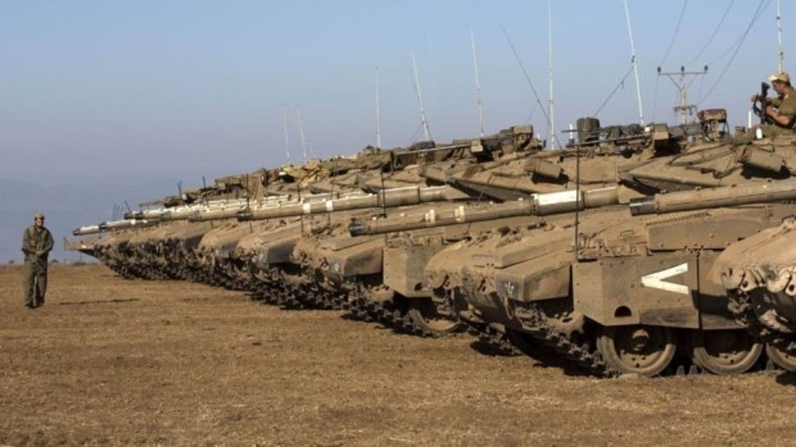 Israeli army Merkava tanks are seen stationed in a deployment training area in the Israeli-annexed Golan Heights near the border with Syria on August 28, 2013 afp