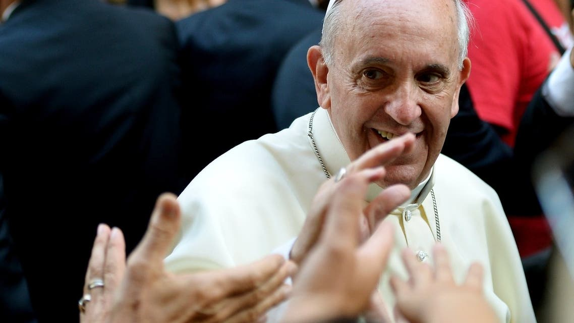 Pope Francis waves at the audience upon his arrival at the Church of Saint Augustine in downtown Rome on August 28, 2013. AFP