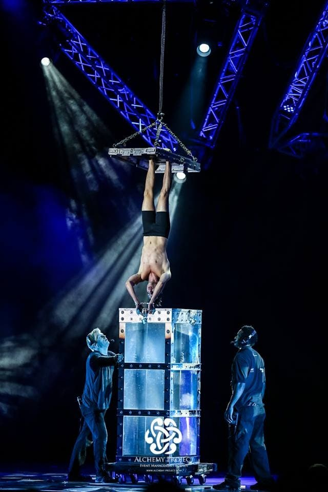 """The Escapologist performed Harry Houdini's famous """"water torture cell"""" act, and had the entire audience holding their breaths with him. (Photo courtesy: Alchemy Project)"""