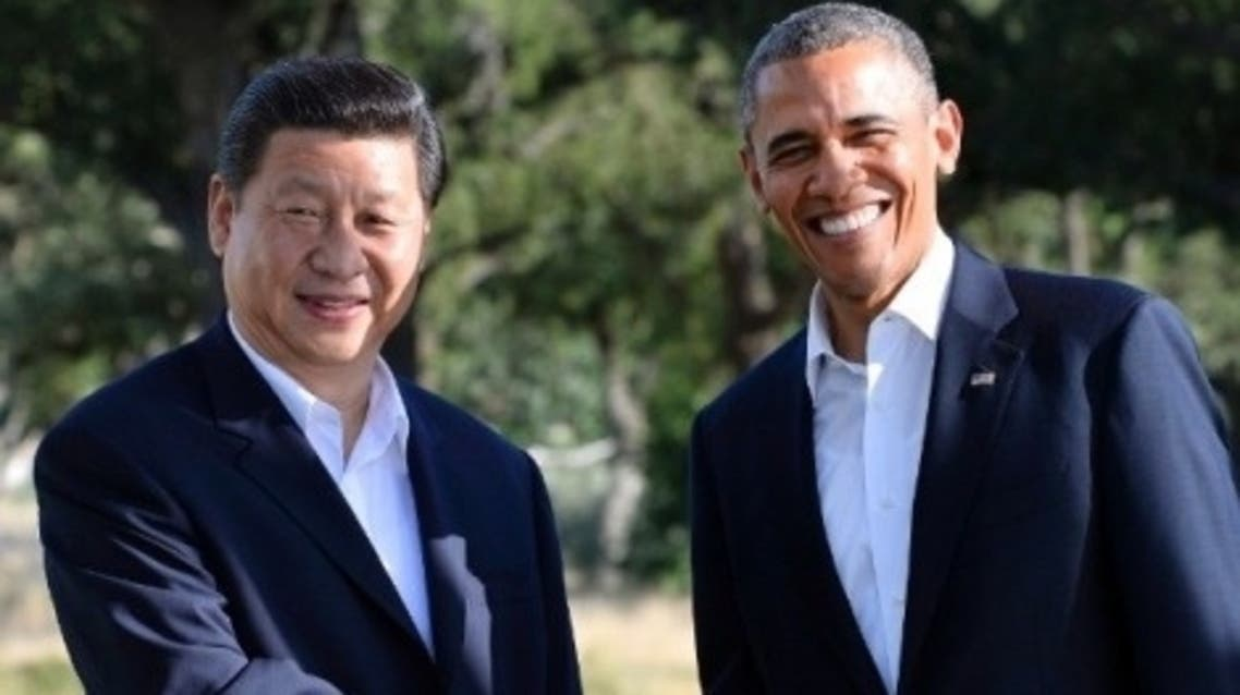 A file photo picture shows Chinese President Xi Jinping and U.S. President Barack Obama. (AFP)