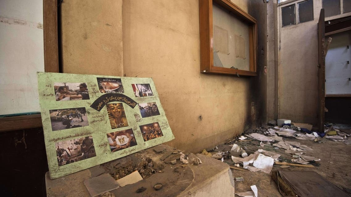 A picture taken on August 26, 2013, shows the vandalized and looted exhibition hall at the Mallawi Museum in the southern Egyptian town of Mallawi. (AFP)
