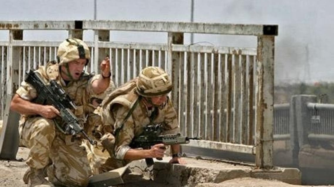 British soldiers secure the site where a military vehicle was destroyed in the southern city of Basra in 2006. (File photo: AFP)