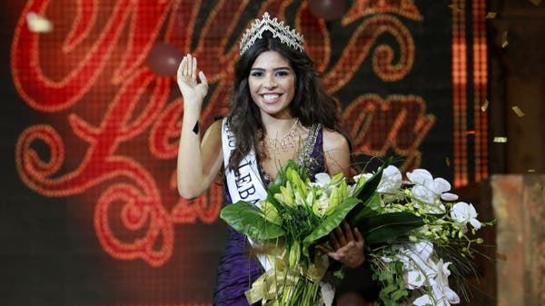 Yara Khoury waves after being crowned Miss Lebanon 2011 in Beirut July 10, 2011. (Reuters)