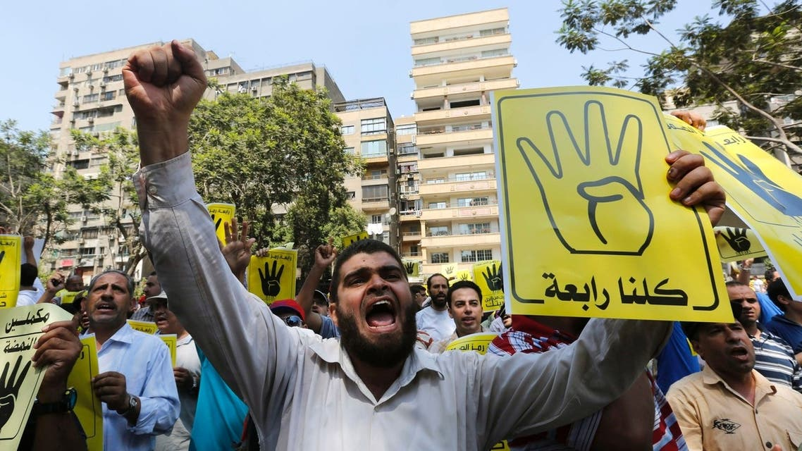 "Members of the Muslim Brotherhood and supporters of ousted Egyptian President Mohamed Mursi shout slogans against the military and the interior ministry as they make the ""Rabaa"" or ""Four"" gesture, during a protest in Cairo August 30, 2013. (Reuters)"