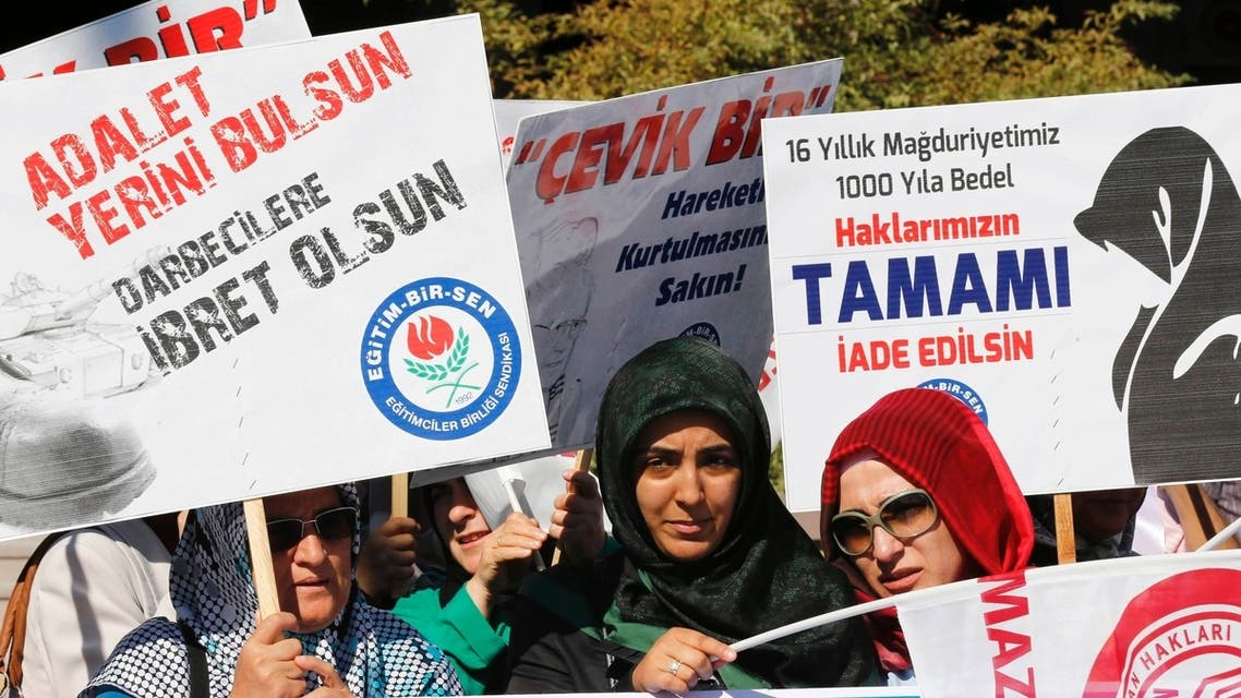 """Women who call themselves """"victims of the post-modern coup"""" demonstrate in front of a courthouse in Ankara September 2, 2013. (Reuters)"""