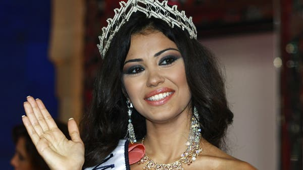 Rosarita Tawil waves to the audience after being crowned Miss Lebanon 2008 during a beauty pageant contest held at the studios of Lebanese television company LBC, north of Beirut, July 11, 2008. (Reuters)