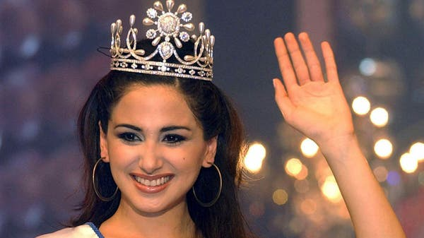 Miss Lebanon Marie-Jose Hnein accepts congratulations after winning a week-long televised beauty pageant that came to a close in Edma, outside Beirut, Friday, May 23, 2003. (Reuters)