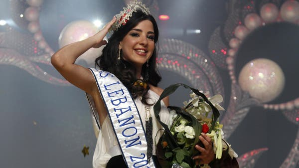 Rahaf Abdallah fixes her tiara after being crowned Miss Lebanon 2010 in Adma, north of Beirut, July 9, 2010. (Reuters)