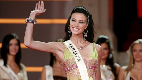 Miss Lebanon Annabella Hilal waves to the audience during the Miss World 2006 welcome dinner in Warsaw September 3, 2006. (Reuters)