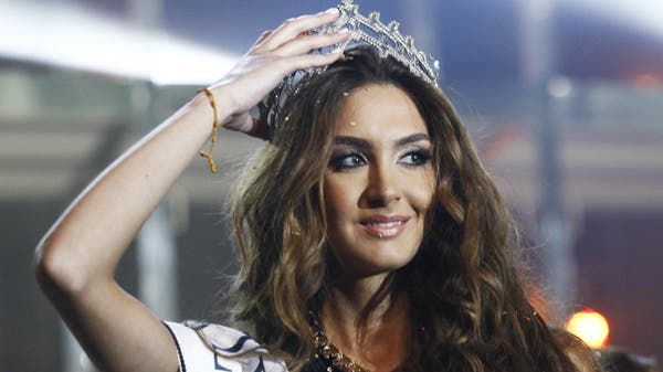 Rina Chibany holds her tiara after being crowned Miss Lebanon 2012 in Platea venue, north of Beirut September 29, 2012. (Reuters)