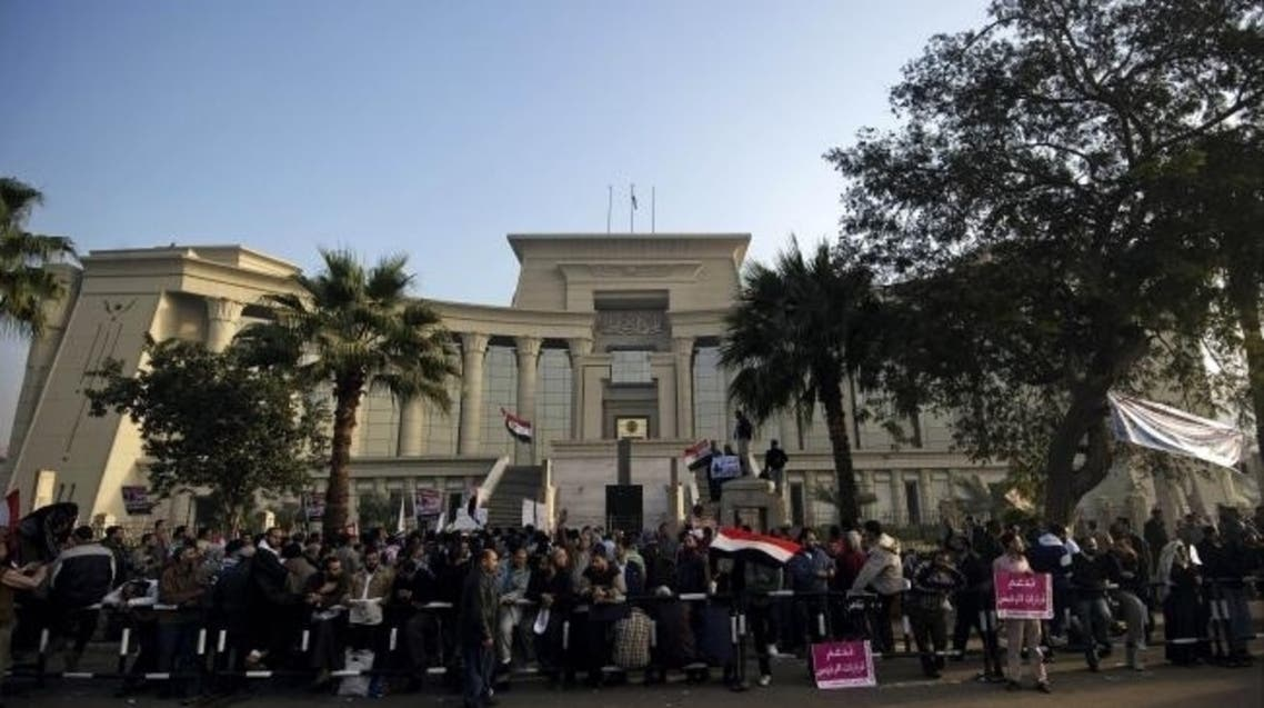 Hundreds of supporters of Egypt's former President Mohammad Mursi protested outside the Supreme Constitutional Court in December 2012. (AFP)