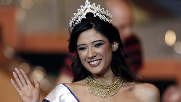 Nadine Njem waves to the crowd after being crowned Miss Lebanon 2007 at a ceremony held at Casino Du Liban, north of Beirut, April 27, 2007. (Reuters)