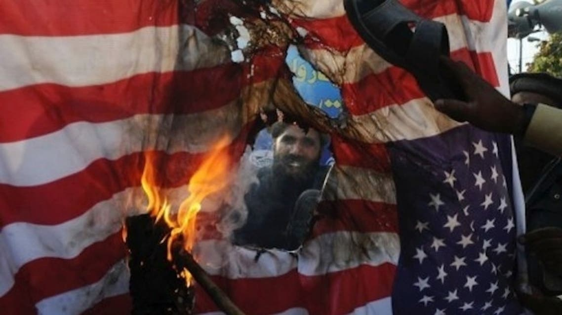 Pakistani protesters burn the U.S. flag at a protest rally in Lahore. (File photo: AFP)