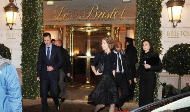 Syrian President Bashar al-Assad (L) and his wife Asma leave the Bristol hotel in Paris in 2010. (File Photo: AFP)