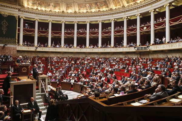 French Prime Minister Jean-Marc Ayrault (L) delivers a speech during a debate about a military intervention in Syria at the French National Assembly in Paris, on Sept. 4, 2013, (AFP)