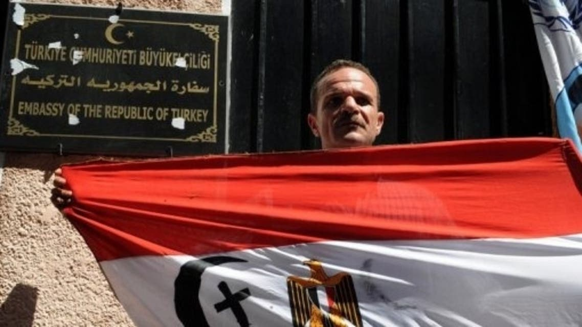 An Egyptian Coptic Christian holds a national flag at a protest outside the Turkish embassy in Cairo, August 29, 2013 (AFP