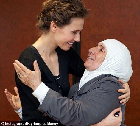 Asma al-Assad seen embracing an old woman. (Photo courtesy: Instagram)