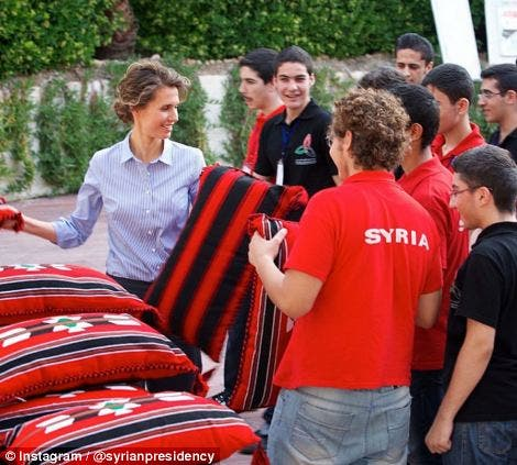 Asma al-Assad hands out supplies on July 24, 2013. (Photo courtesy: Instagram)