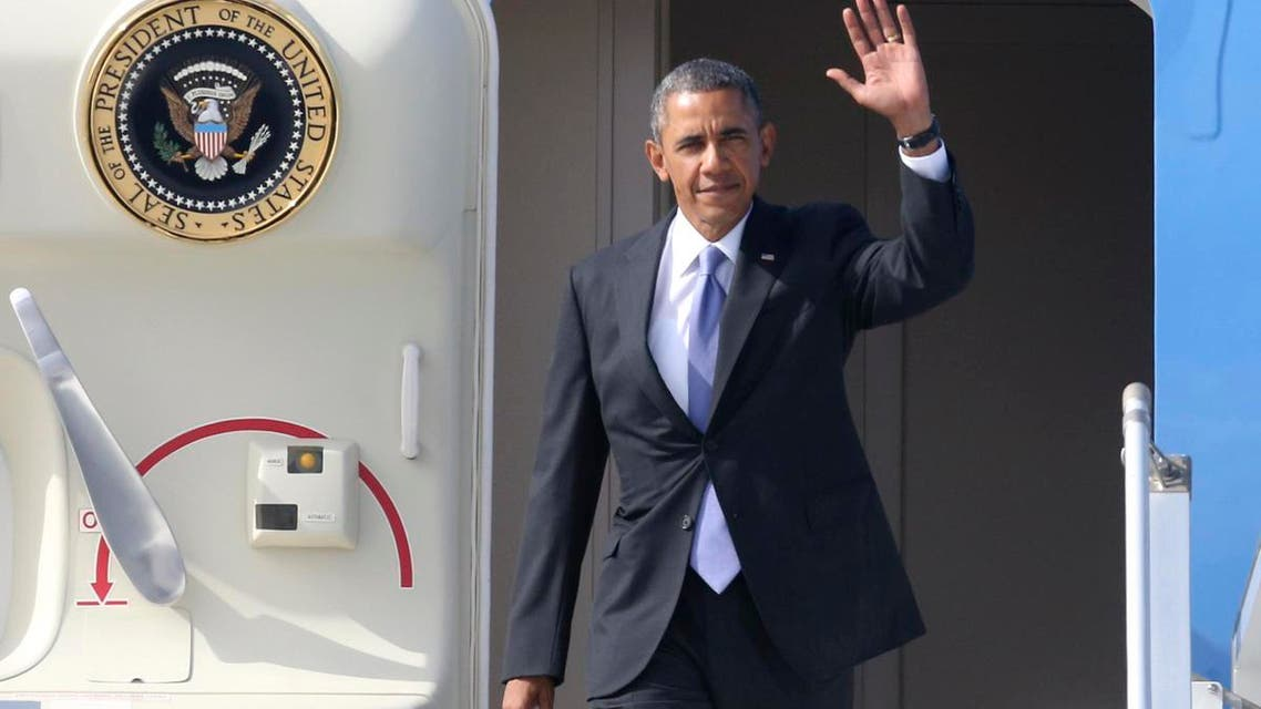 U.S. President Barack Obama waves as he arrives to take part in the G20 Summit in St. Petersburg, September 5, 2013. (Reuters)