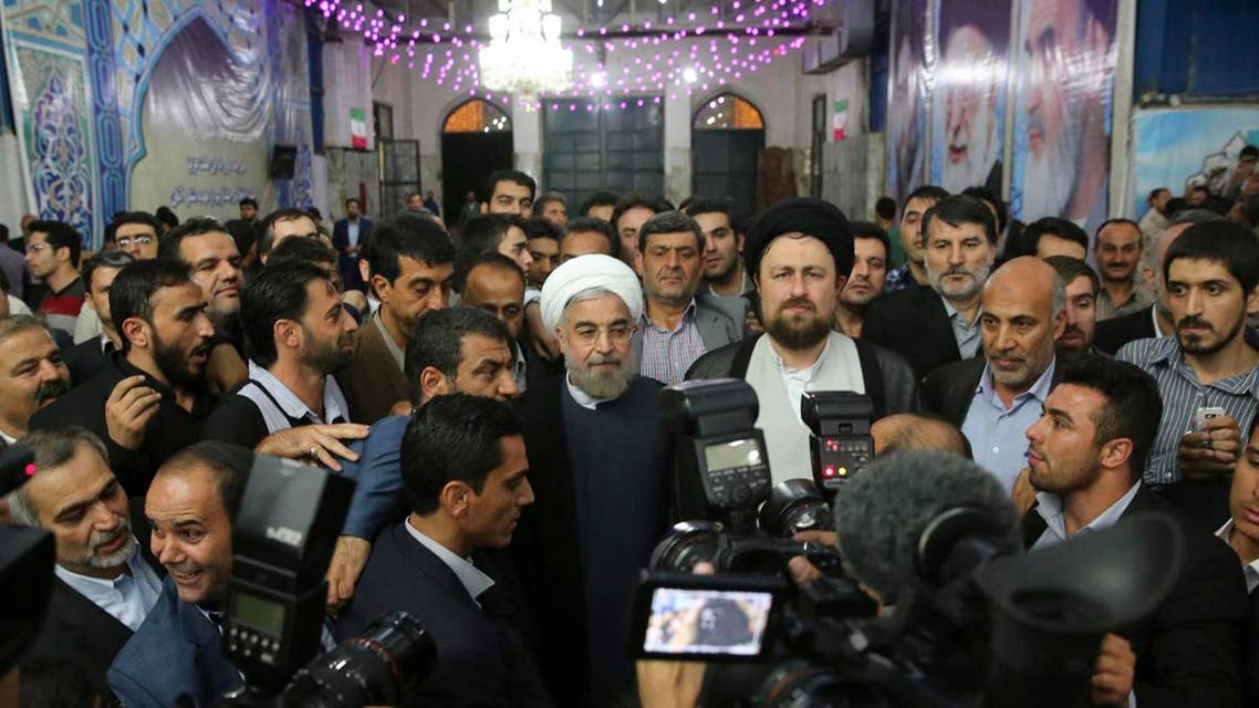 Iranian President-elect Hassan Rohani (C) speaks to the media following a visit to the Khomeini mausoleum in Tehran June 16, 2013.