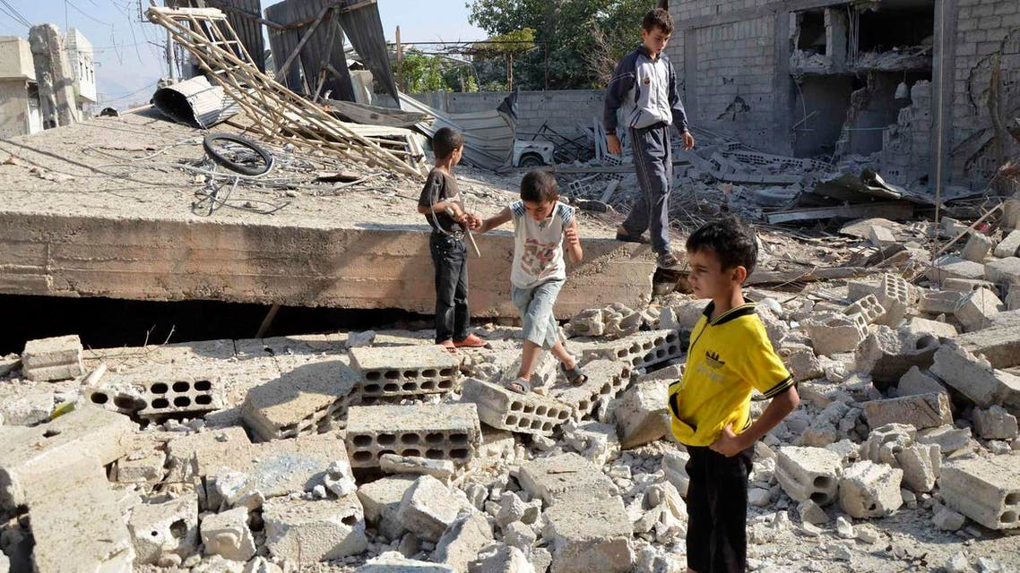 Boys walk on the rubble of a building hit by what activists said was shelling by forces loyal to Syria's President Bashar al-Assad, in the Duma neighbourhood of Damascus September 4, 2013. (Reuters)