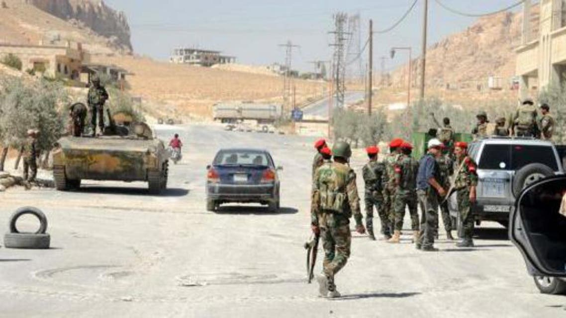 Syrian army forces are seen in the Christian town of Maalula on September 7, 2013 (AFP)