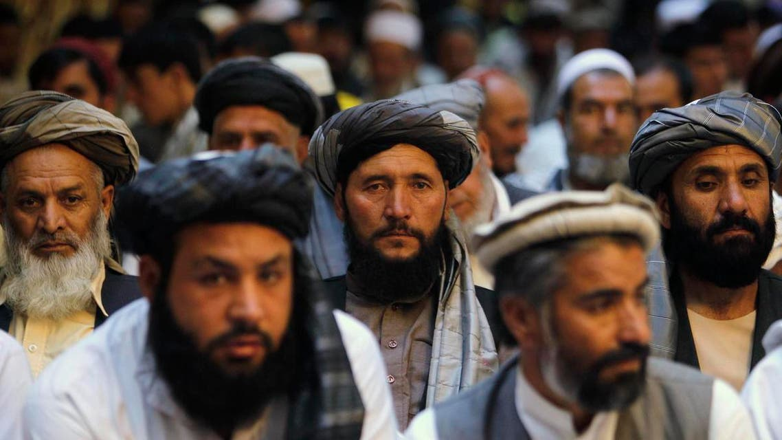 Afghan men attend a gathering launched by a political party ahead of an election campaign in Kabul September 3, 2013. reu
