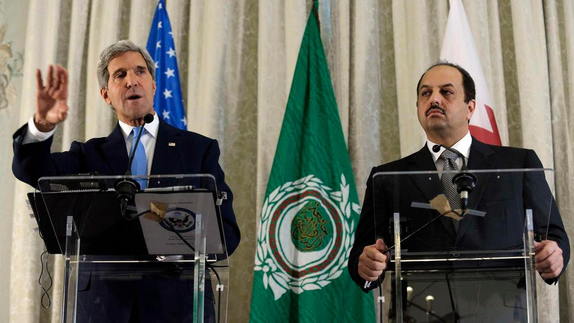 U.S. Secretary of State John Kerry answers a question during a news conference with Qatar Foreign Minister Khalid Al Attiya (R) at the United States Embassy in Paris, September 8, 2013. (Reuters)