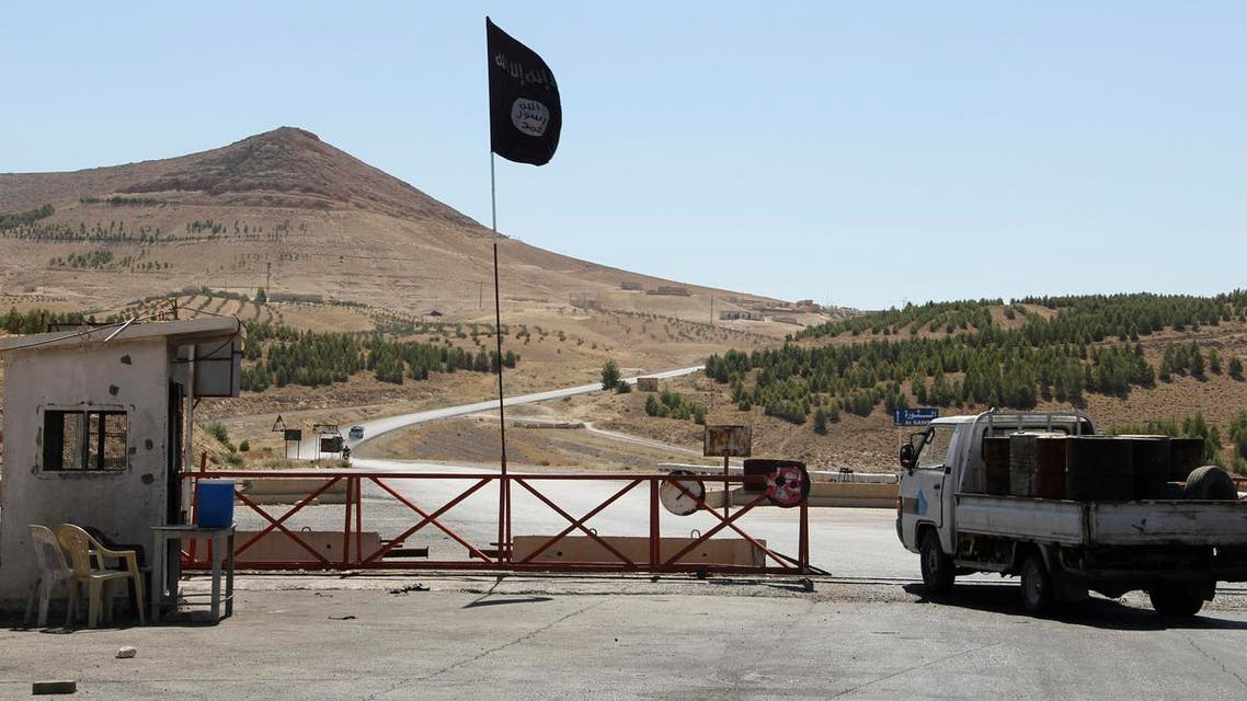 A vehicle carrying supplies stands at a checkpoint of Islamist Syrian rebel group Jabhat al-Nusra in the Deir al-Zor countryside, July 27, 2013. reu