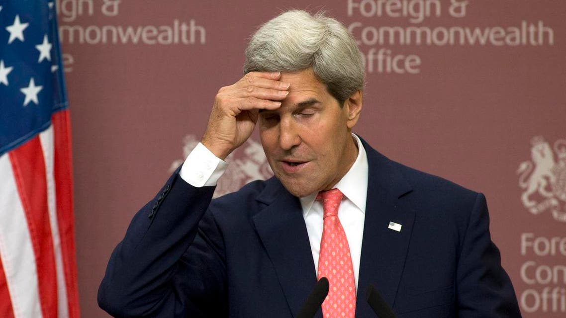 U.S. Secretary of State John Kerry reacts during his joint news conference with Britain's Foreign Secretary William Hague at the Foreign and Commonwealth Office in London September 9, 2013. reu