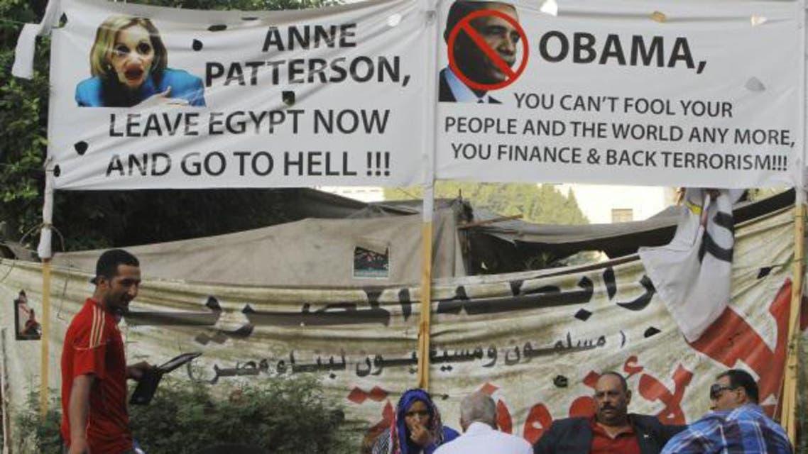 شعارات تتهم ادارة اوباما بدعم الارهاب في مصر