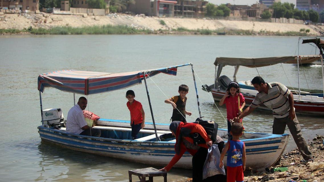 Boat owners wait for customers along the Tigris River which flows through the Iraqi capital of Baghdad on September 11, 2013. (AFP)