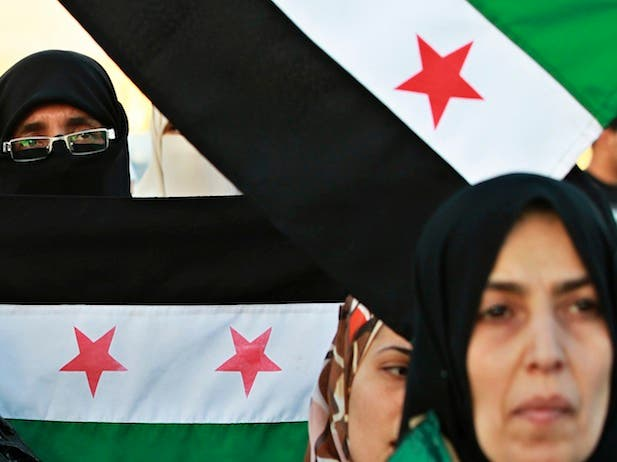 Syrians protest outside the Syrian embassy in Amman, Jordan, May 2012 reuters
