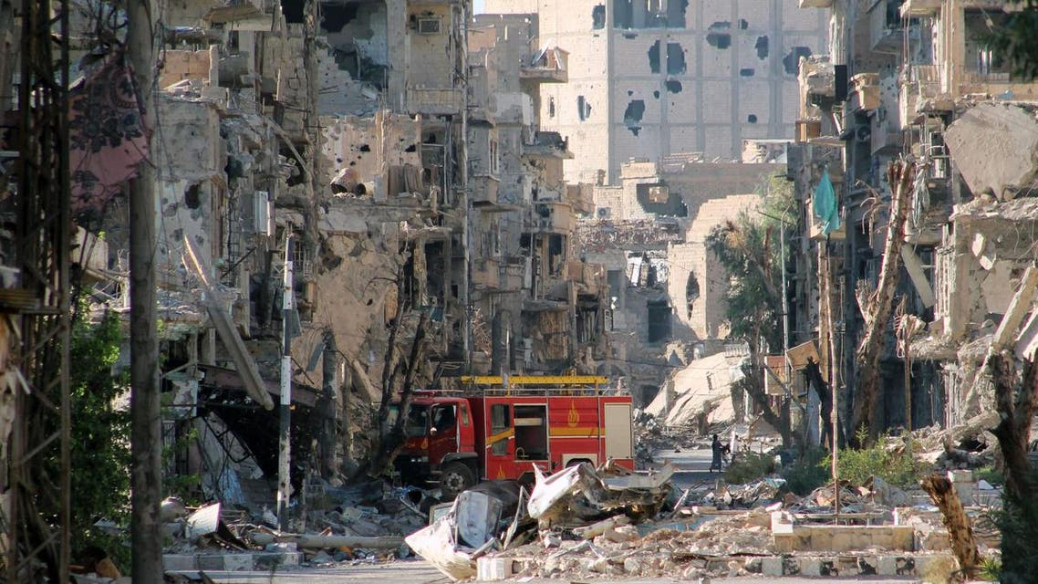 A picture shows a firetruck left amid heavily damaged buildings in the Syria's eastern town of Deir Ezzor on September 10, 2013. (AFP)