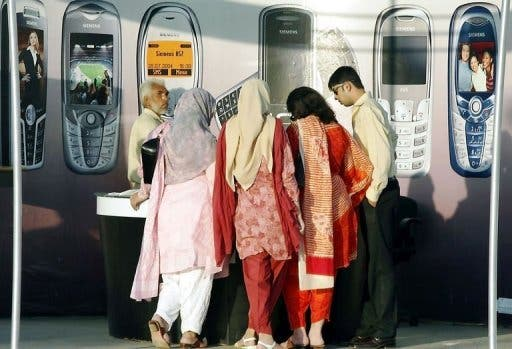 Women visit a stall a mobile phone exhibition in Islamabad in 2005. In a country, where parents keep young people on a tight leash and dating is considered inappropriate, late-night chatting over the phone or Internet can be a way to find love below the radar. (AFP)