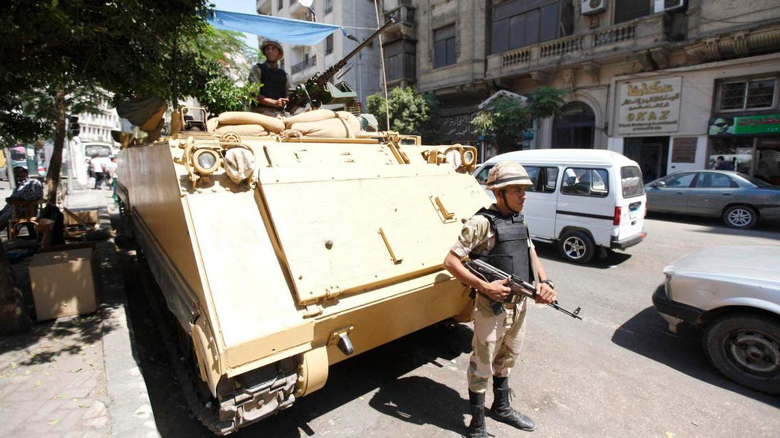 A soldier stands next to an armored personnel carrier (APC) near the al-Fath mosque on Ramses Square in Cairo, September 11, 2013. (Reuters)