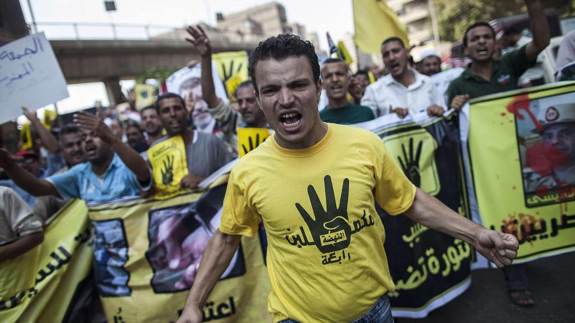 Members of the Muslim Brotherhood and supporters of ousted President Mohamed Mursi march through Cairo's Moandessen neighborhood on September 6, 2013. (AFP)