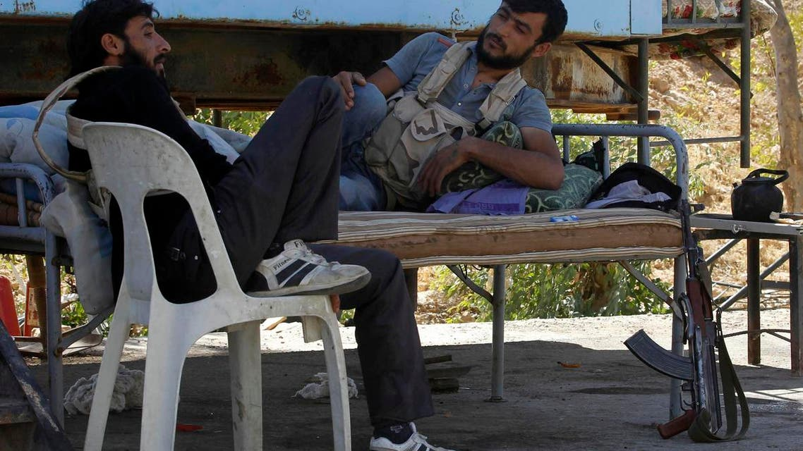 Free Syrian Army fighters relax near oil wells (not seen) that are now under the control of the Free Syrian Army, according to activists, in Raqqa province September 12, 2013. (Reuters)