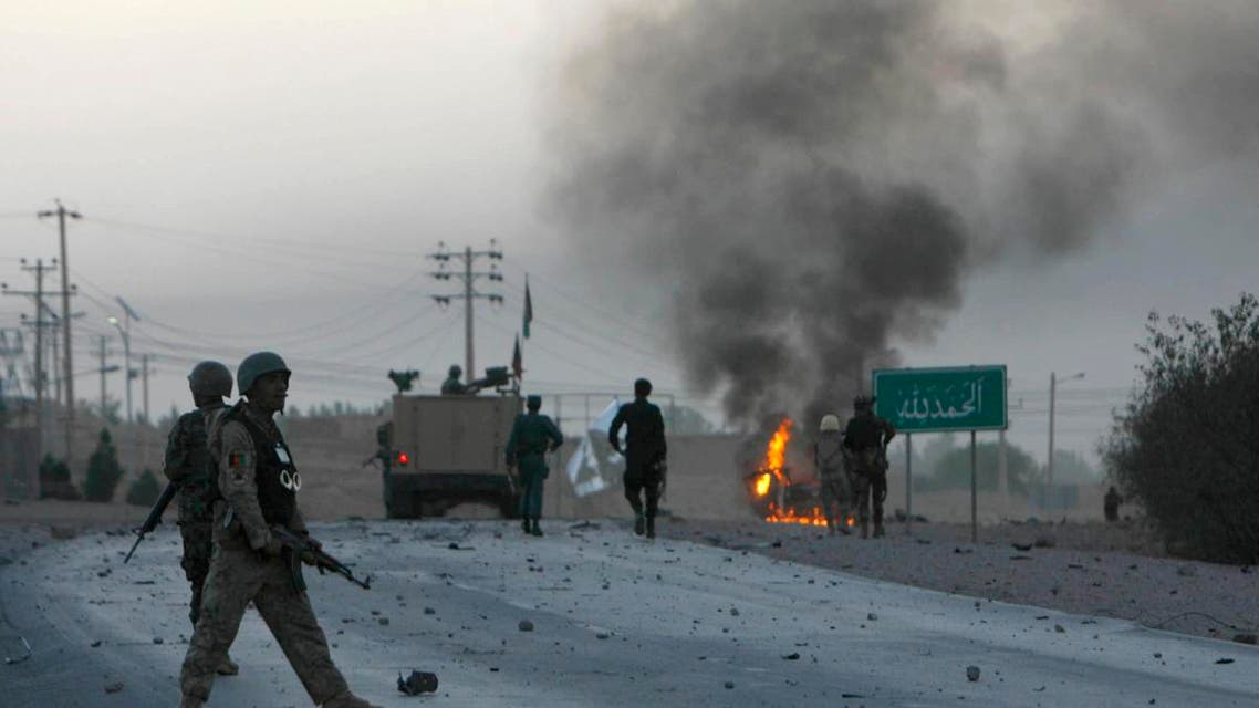 Afghan soldiers walk towards flames outside the U.S. Consulate after an attack by insurgents, in Herat province September 13, 2013. (Reuters)