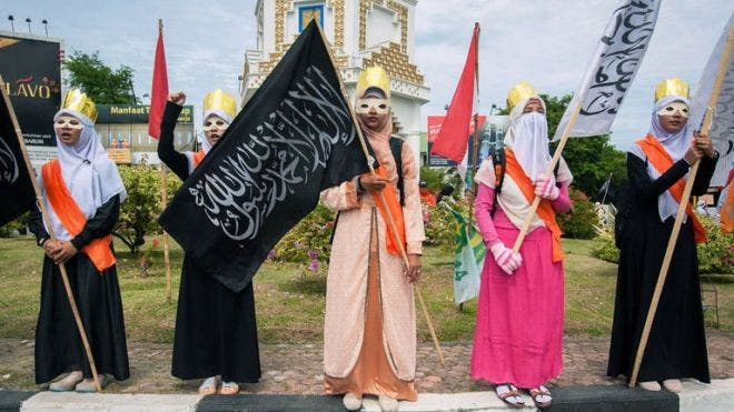 Muslim women stage a protest against the Miss World beauty pageant contest this month. (AFP)